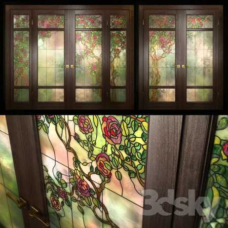 A set of two double doors with stained glass